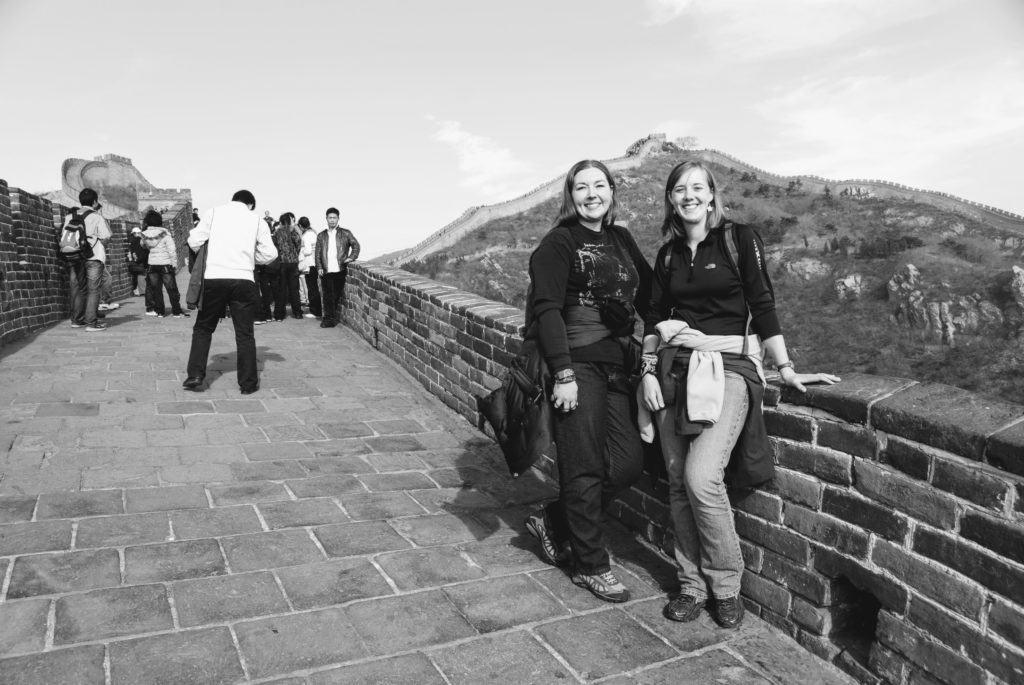 the great wall in China two friends traveling together