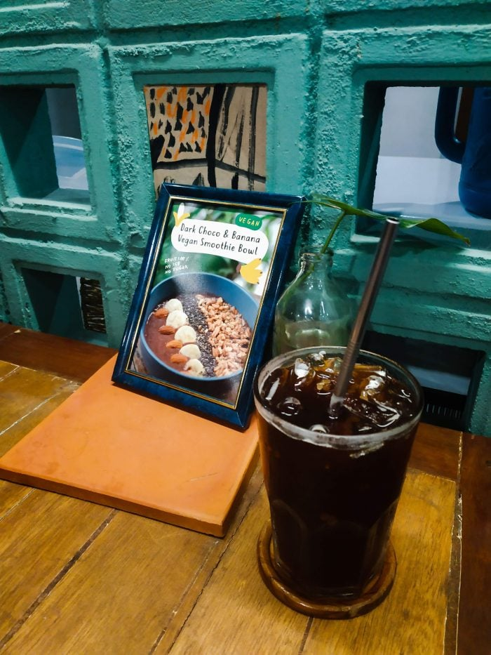 Iced Americano with metal straw