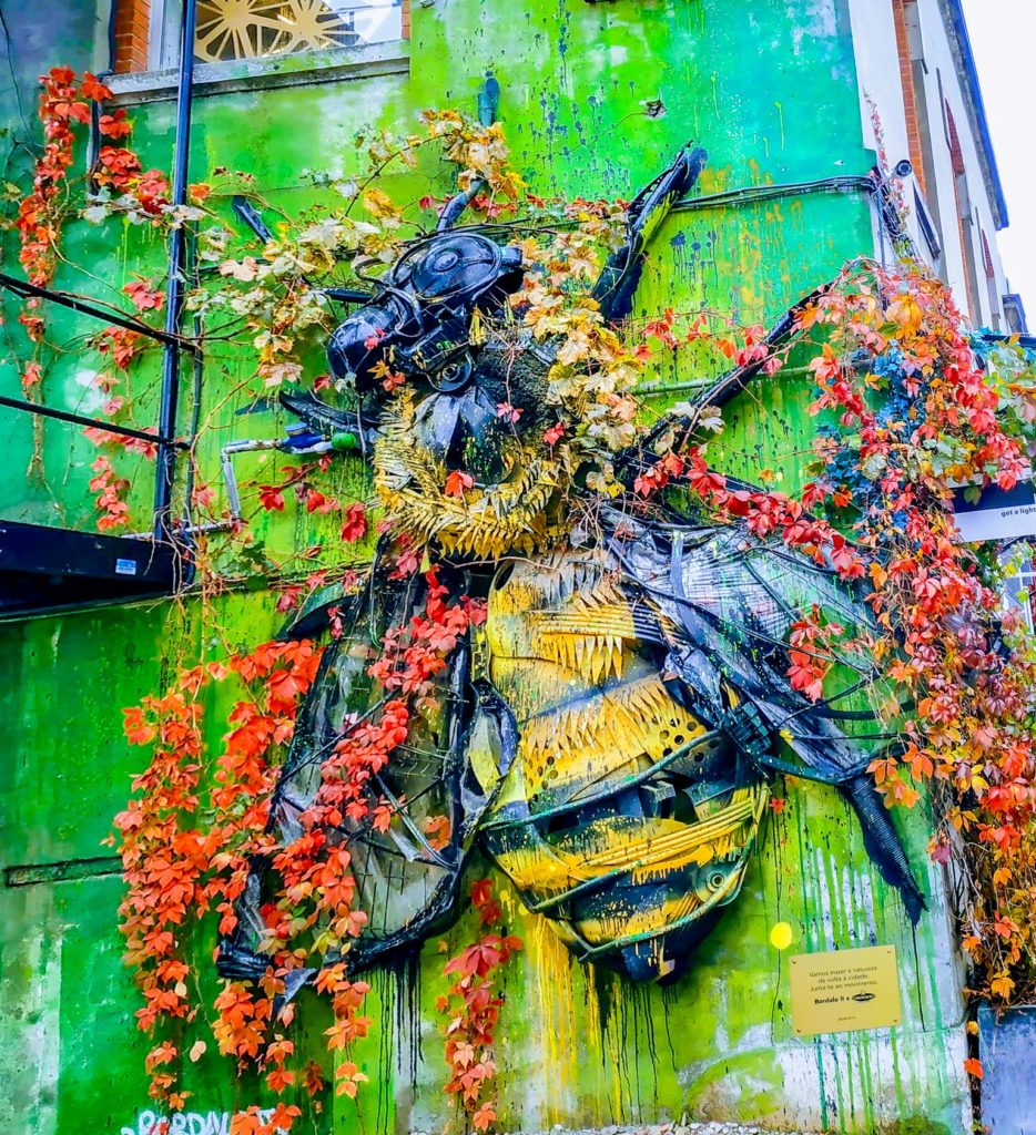 An outdoor art piece that looks like a bee in Lisbon's LX Factory