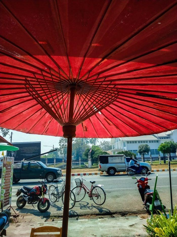 Sitting underneath an umbrella drinking smoothies