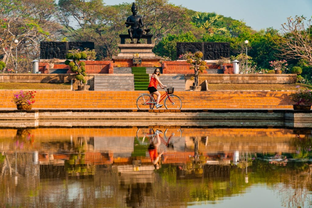 Water reflections of a person on a bike in Sukhothai Thailand