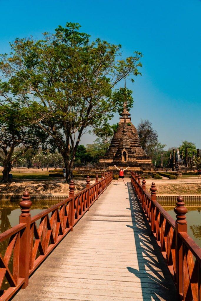 bridge over water to temple in Sukhothai Thailand