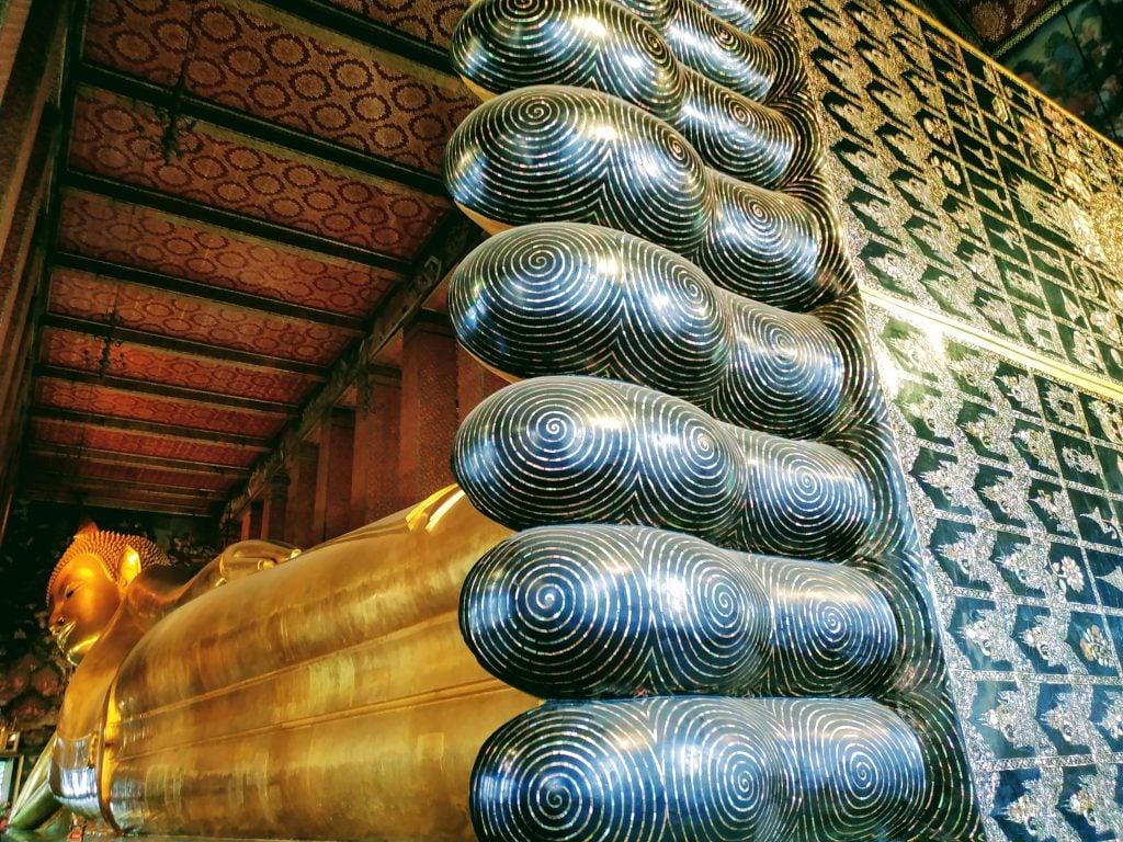 Enormous gold reclining buddha in Bangkok