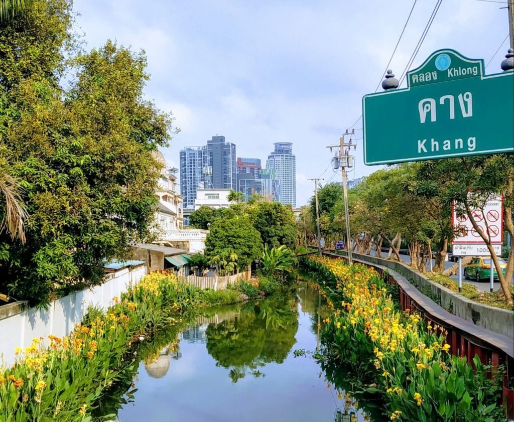 Canal in Bangkok with flowers