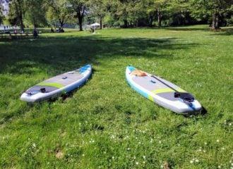Two SUPs at Lake Sammamish Park on the grass