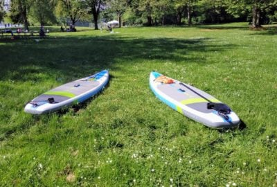 Two SUPs at Lake Sammamish Park on the grass