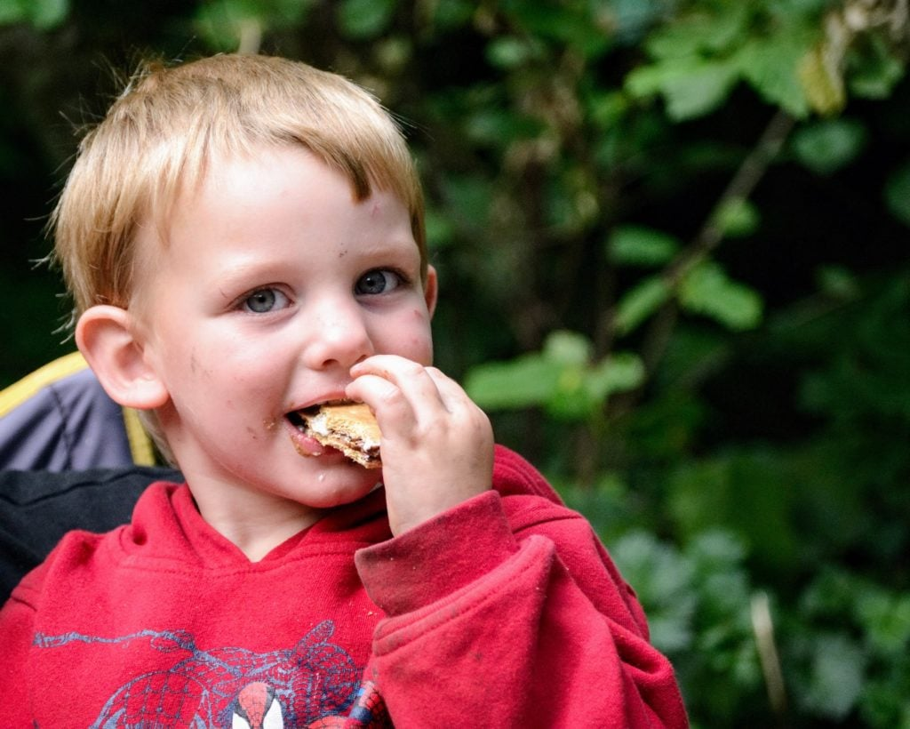 boy eating s'mores for the first time