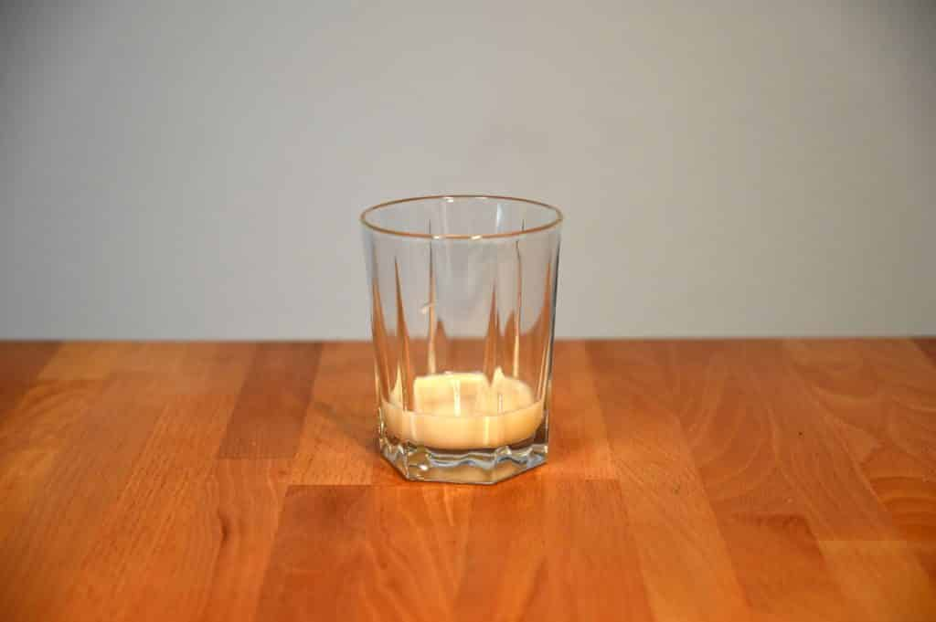 glass with sweetened condensed milk