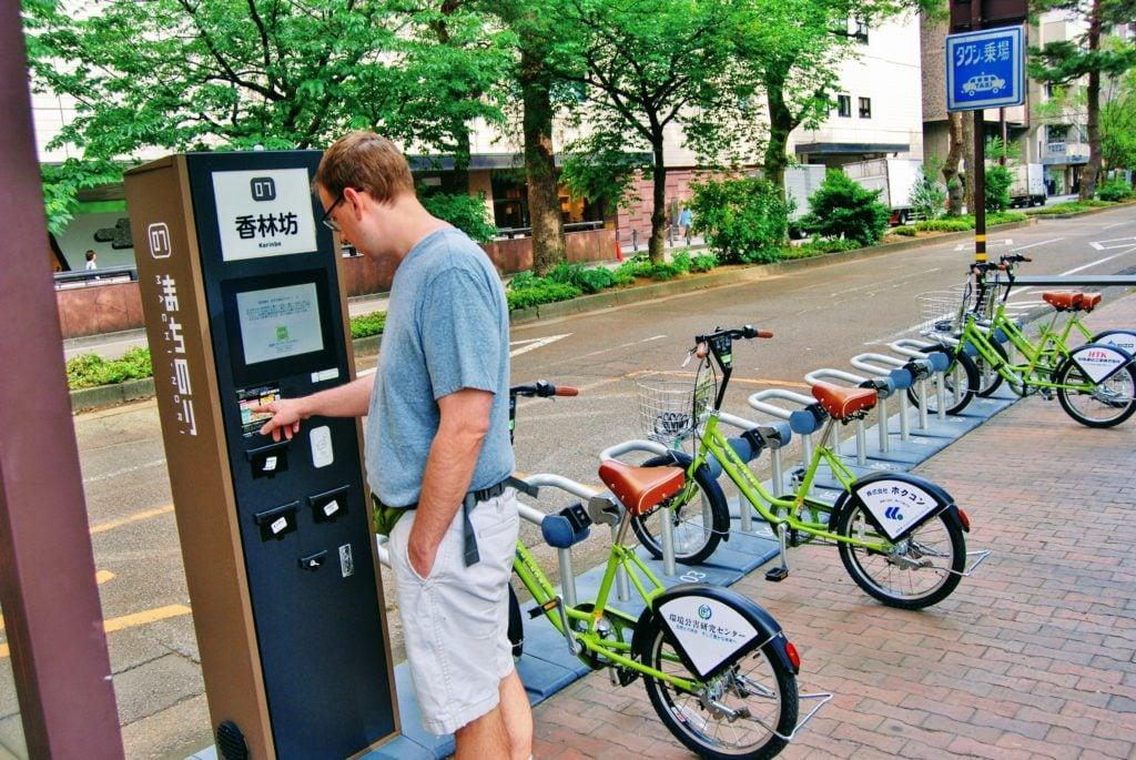 man at bike station in Kanazawa, Japan.