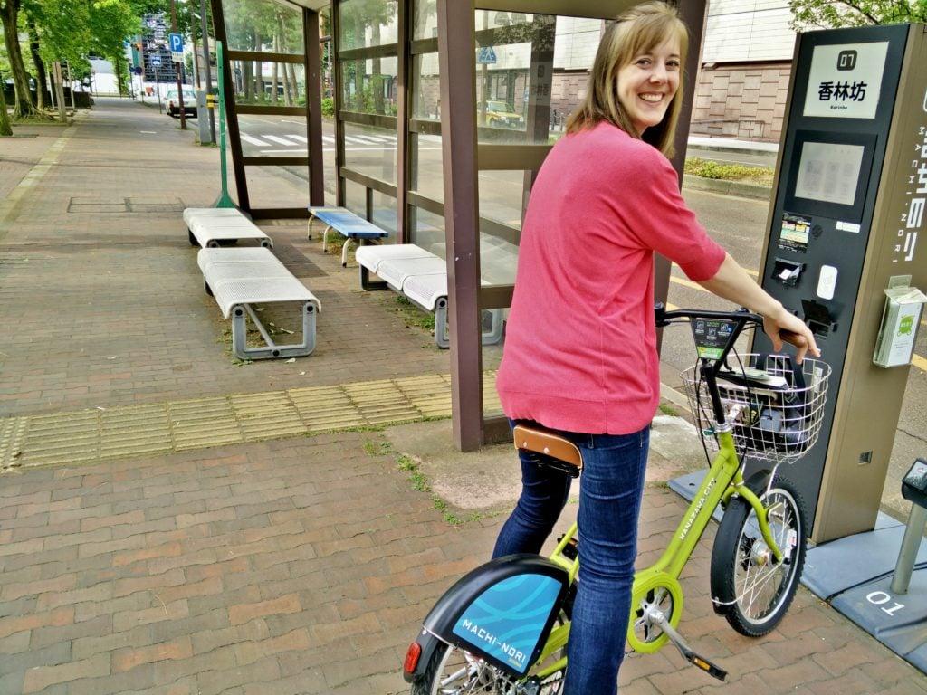 girl on public bike in Kanazawa Japan