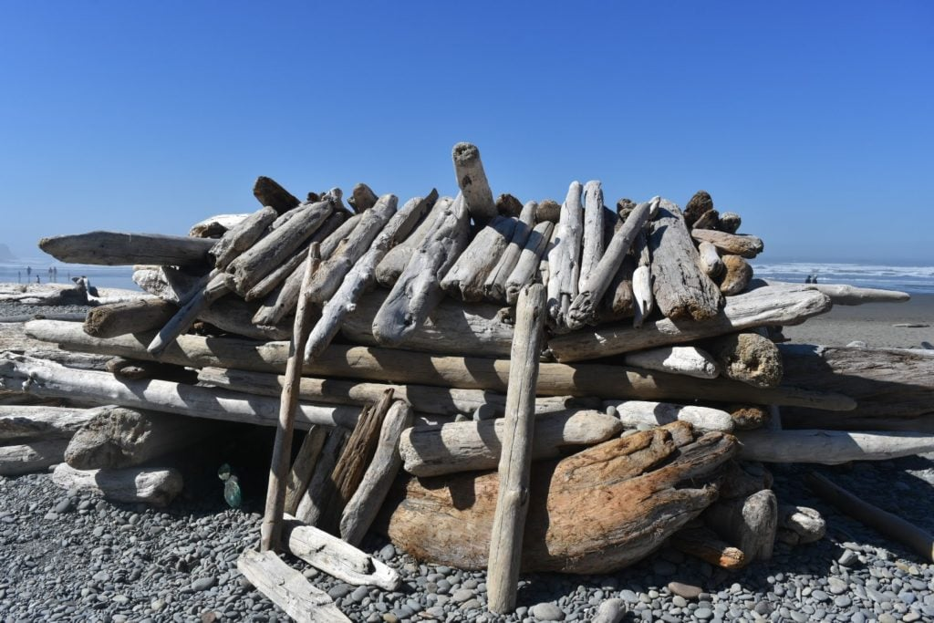 fort on the beach made from driftwood