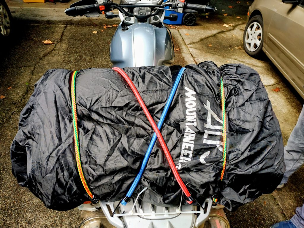 Dual Sport Motorcycle tent packed on the back with bungees and rain cover