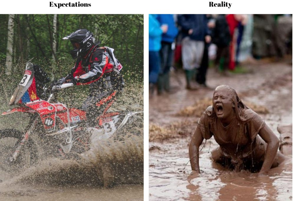 off road rider thru puddle with woman covered in mud