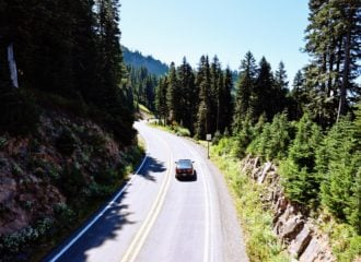 Car driving down road near Mt Rainier