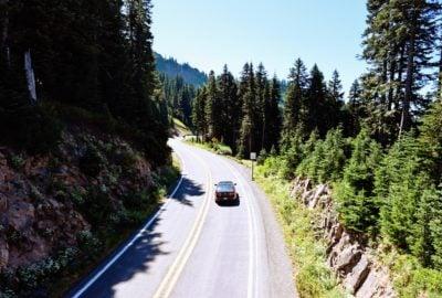 Car driving down road near Mt Rainier