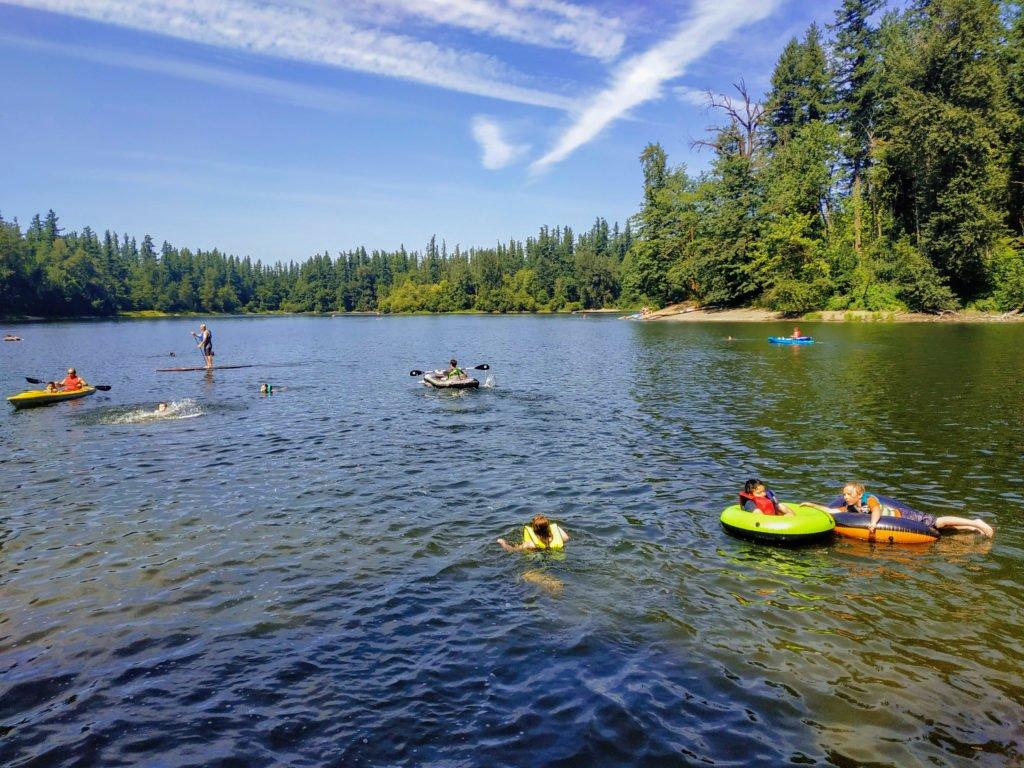 people swimming in Deep Lake