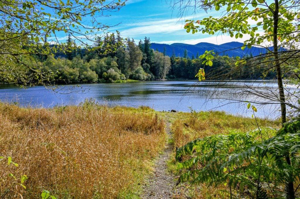 small path leading down to deep lake