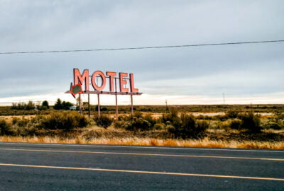 Motel sign on the side of the road