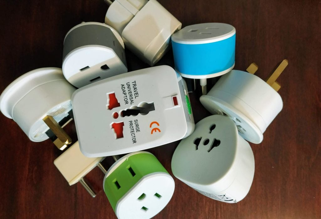 pile of travel adapters