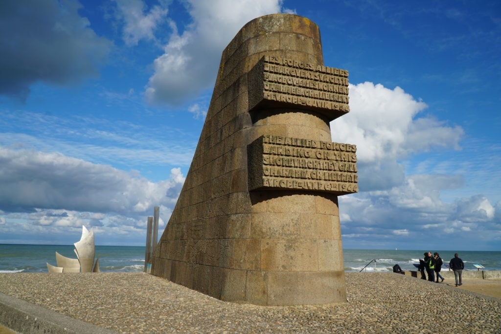 A stone memorial at Omaha beach commemorating D-Day.