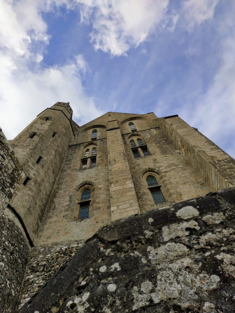 looking up at the abbey towering above