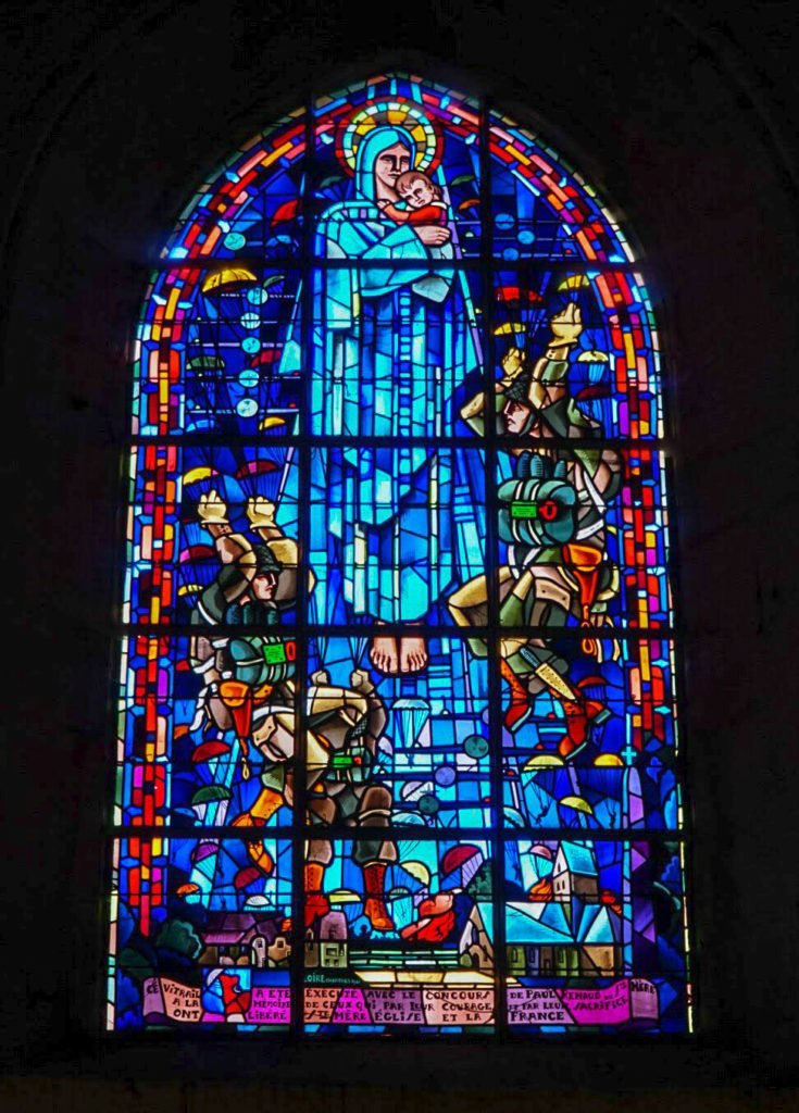 stained glass window of angel and paratroopers