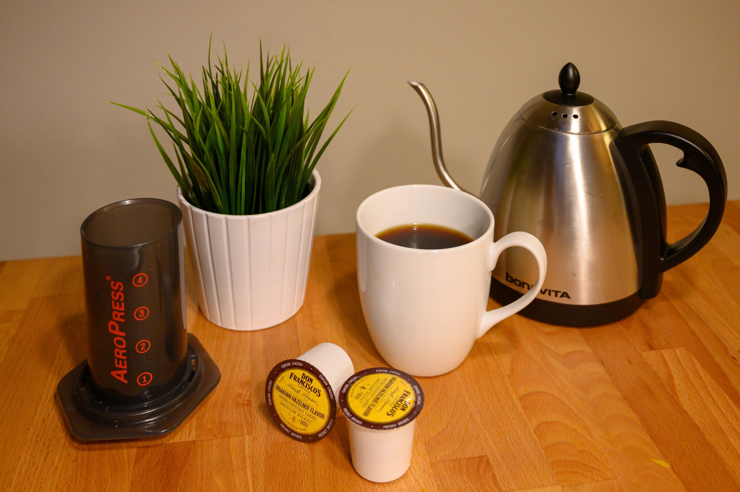 coffee with aeropress, k-cups and hot water kettle