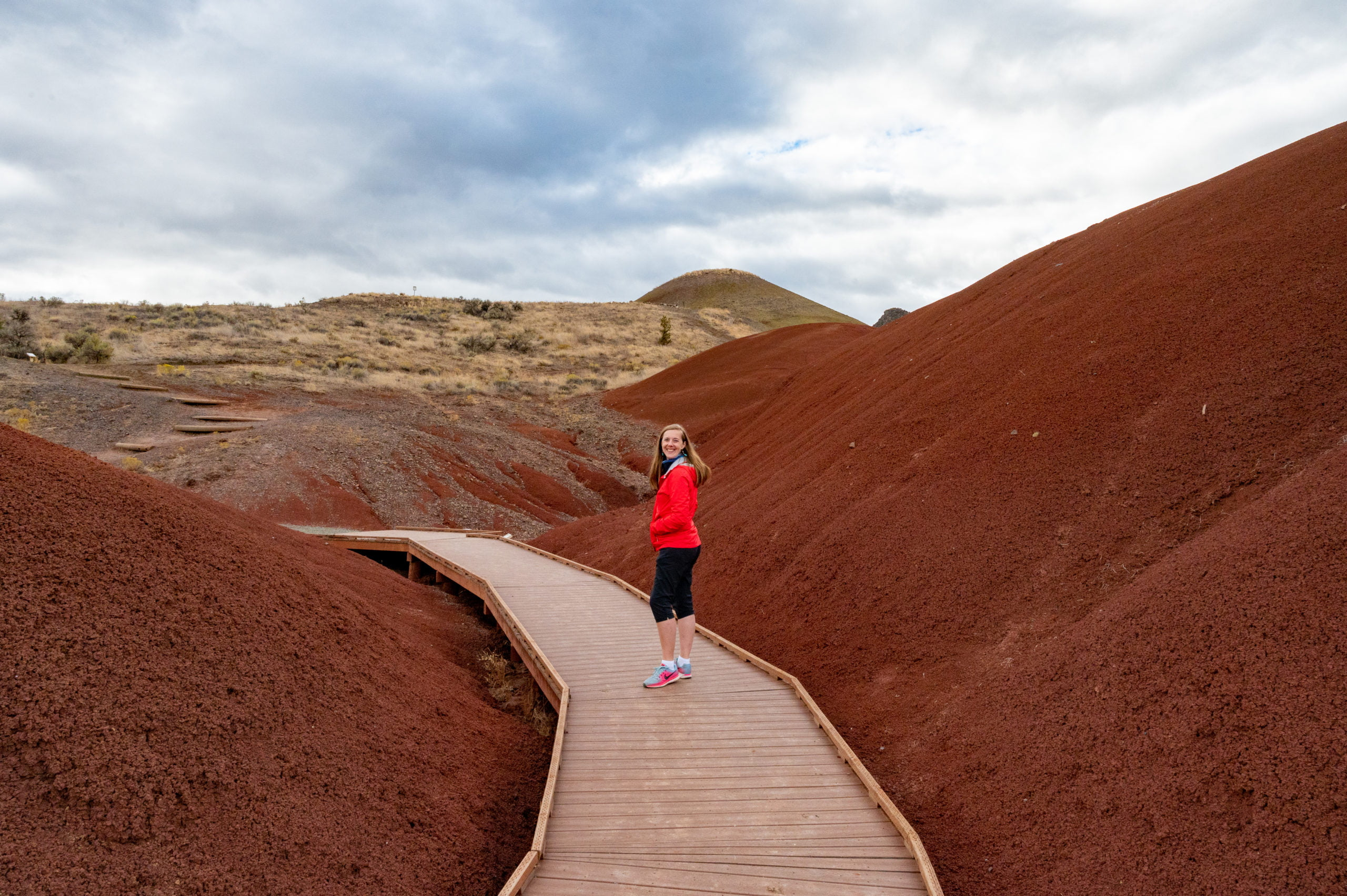 person walking on boardwalk at painted cove in the painted hills