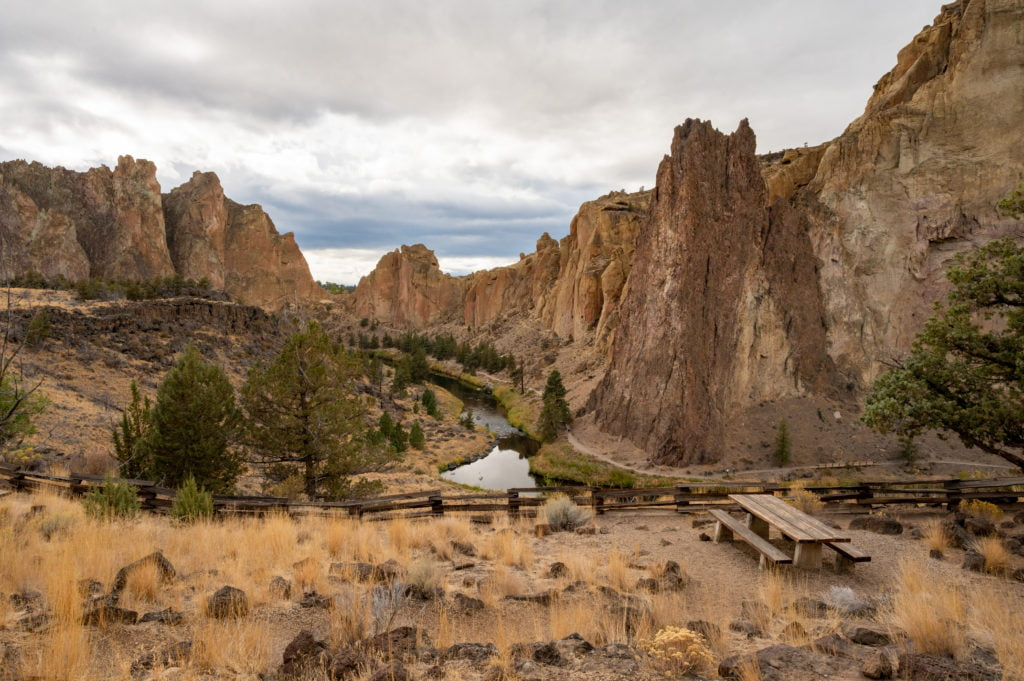 a picnic table with view of smith rock state park