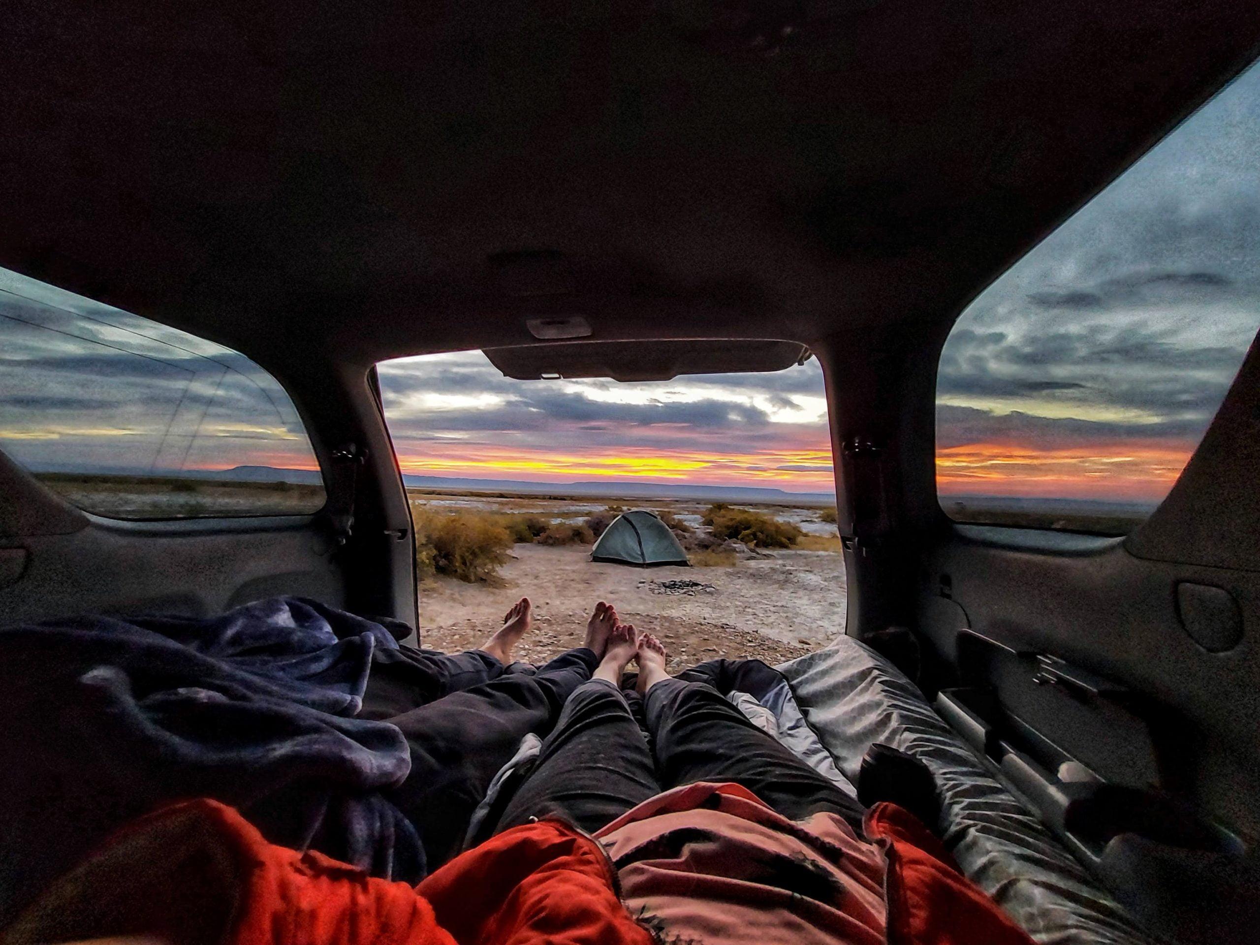 sleeping in car sunrise in the desert