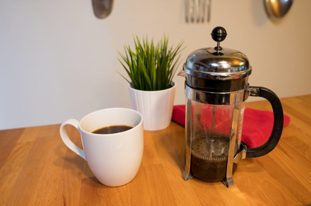 French Press Coffee and plant