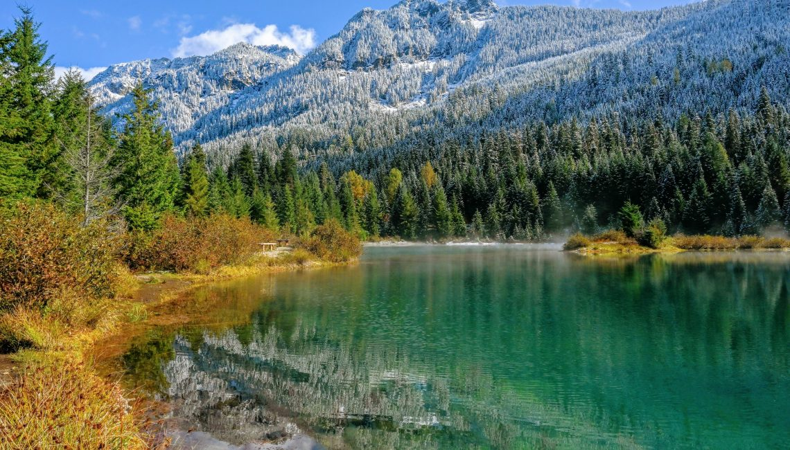 Gold Creek Pond with fall colors and snowy mountain