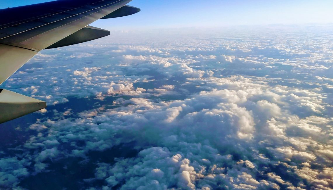 view from airplane over the clouds