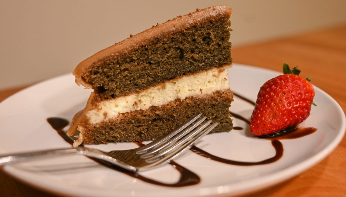 Coffee Cake with strawberry on the side