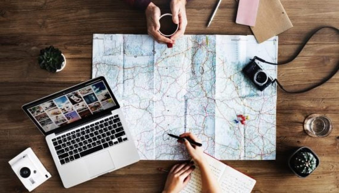 Two people planning travel Map
